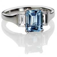example image of a platinum engagement ring set with an Aqua-marine stone and diamond side stones